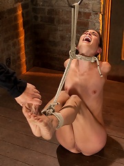 Sexy Amber has her elbows bound together, ankles to neck, and endures foot canning, brutal orgasms.