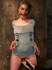 Redhead with cute freckles bound tightly & made to cum! Big puffy nipples clamped & weighted