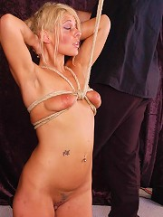 Blonde slave in bondage and electro pain action